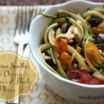 puttanesca style zucchini noodles with olives and cherry tomatoes
