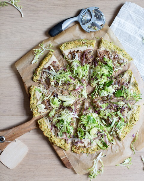 cauliflower + brussels sprout crust pizza with a white bean spread, caramelized onions + shredded sprouts - what's cooking good looking