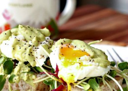 Poached eggs on Sourdough toast with avocado sauce and and microgeens