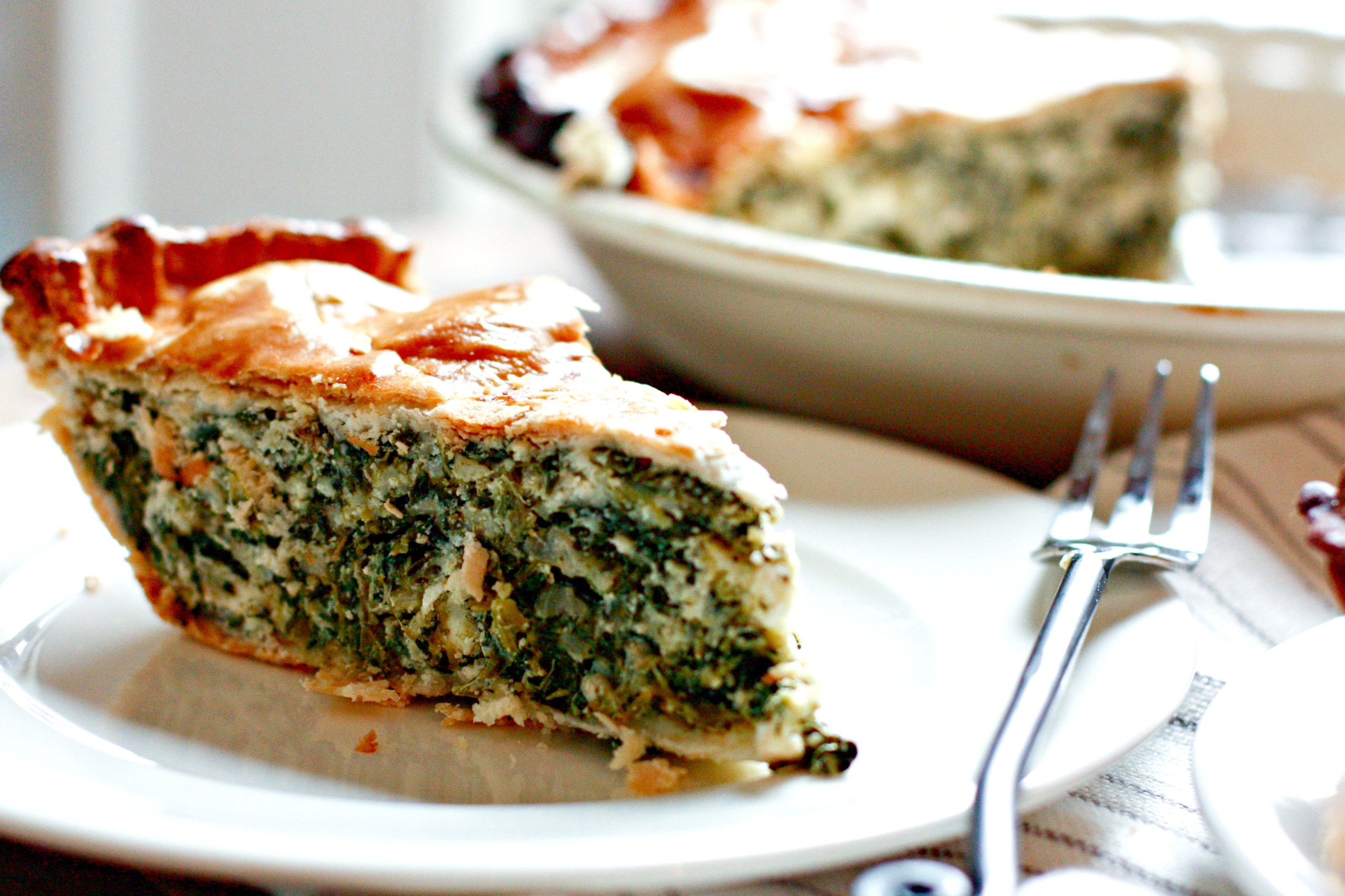 My mom's famous spinach pie is an easy crowd pleaser! It's cheesy and...