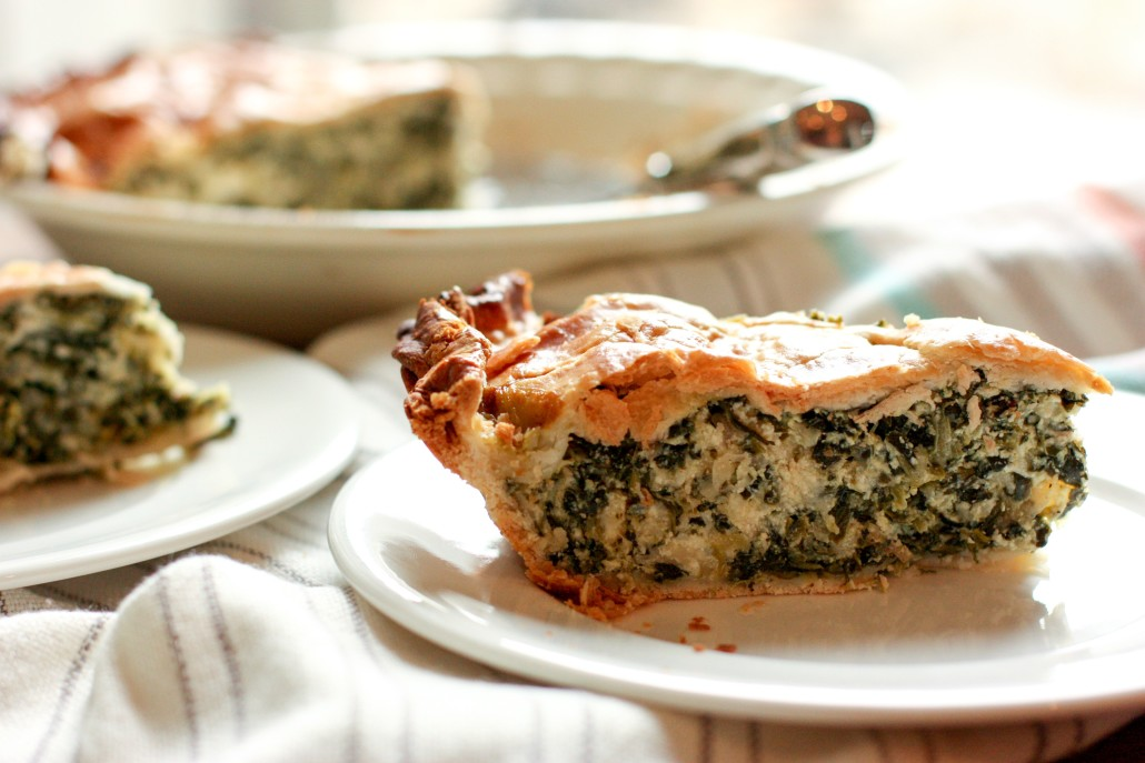 My mom's famous spinach pie is an easy crowd pleaser! It's cheesy and delicious, but still chock full of healthy greens! #dinner #cleaneats @danielleomar