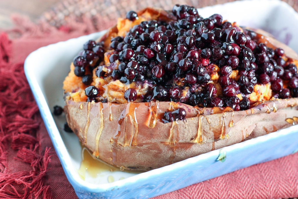 Warm Wild Blueberries poured over a twice Baked Sweet Potato -- so decadent and so delicious! Perfect healthy holiday side dish recipe or weeknight dinner!